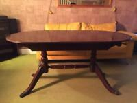 Extending dining table Dark wood
