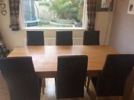 Solid Oak dining table and matching sideboard