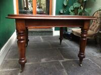 Edwardian hardwood extendable dining table. Seats up to 8/10 people depending on leafs.
