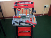 Black & Decker children's toy workbench with mixed tools