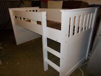 A WHITE FRAMED CABIN BED