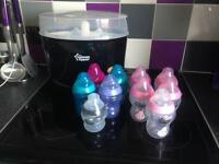 Brand new steriliser with 10 bottles