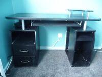 Black computer desk, 120L, 55W, 75H, slide out keyboard shelf, monitor shelf, two drawers.