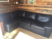 Stunning leather corner sofabed with storage