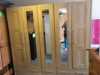 LARGE 5 DOOR 5 DRAWER WARDROBE COMES IN 3 PARTS 3 DOORS ARE MIRRORED HANGING RAILS AND SHELVES VGC