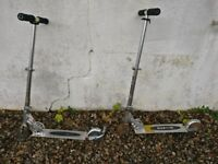 2 micro scooters, silver