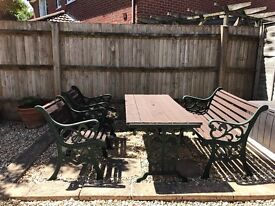 Cast iron and wood table, bench and chairs