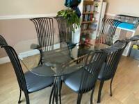 Cast iron and glass table and chairs x6