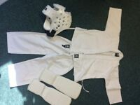 Childs martial arts suit with headguard and shin protection £10 for the lot