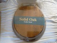 Solid Oak Toilet Seat, Brand New but brass has tarnished