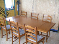 Exceedingly nice extending dining table and 6 ladderback chairs in very good condition.