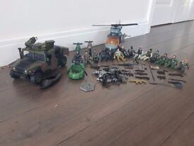 Toy soldiers with helicopter, jeep, motorbikes, boat, canoe, guns and accessories
