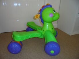 Fisher Price stand and stride Dino Ride on Dinosaur.