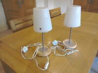 Two lamps silver chrome stand on light beech wood base with white glass shade