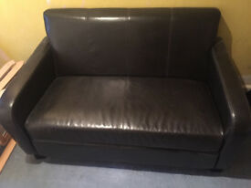 Brown two seat leather look sofa