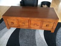 Coffee Table by NEXT in solid mango wood. Good condition with four drawers. Brown furniture