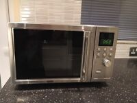 DeLonghi polished silver finish microwave oven
