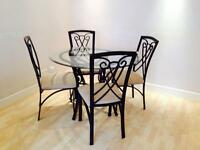 Glass ironwork dining table