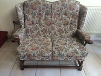 COTTAGE STYLE 2 SEATER SOFA/SETTEE, GOOD STURDY CONDITION, SOLID WOOD ARMS AND FRAME