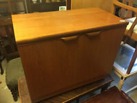 Retro teak cabinet with 2 shelves , one pulls out . Free local delivery.