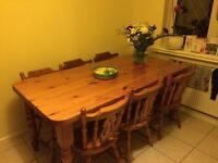 Solid Pine Dining table with six chairs.