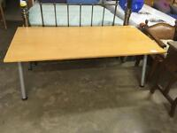 Large desk with extendable legs