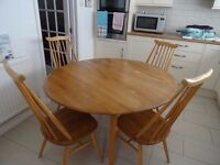 Ercol table and four chairs, good solid condition but needs a little sanding and refinishing.