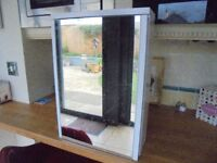 White bathroom cabinet with hinged door and mirror