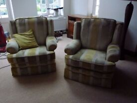 Pair of arm chairs with solid wooden frames