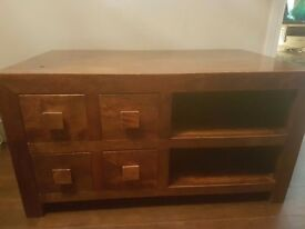 Solid wood tv unit with 4 drawers.