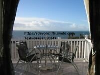 DEVON CLIFFS SANDY BAY EXMOUTH DEVON Two Bedroom Front Row Caravan with Veranda for Hire