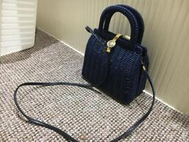 Vintage 1970's lacquered wicker handbag