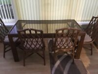Glass Dining room table and six chairs
