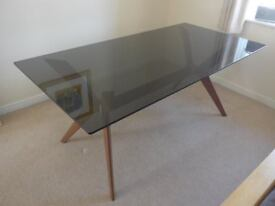 Calligaris Glass-topped Dining Table. Excellent condition. Grey smoked glass top and walnut base.