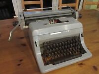 Olivetti Typewriter Linea 88 with spare ribbons and erasers - UNTESTED