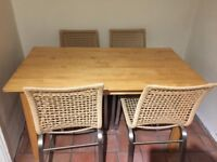 Very solid pine dining table and 4 chairs.