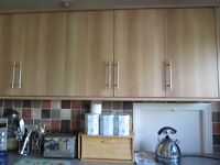 Complete range of kitchen units including work-surface, cooker, hob, sink unit and extractor
