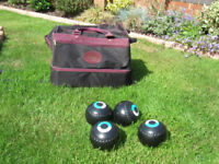 A set of 4 x Size:5 Lawn Bowls by Henselite in a fitted roll along carrying case
