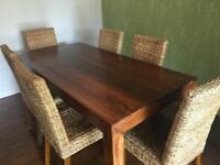 Next solid mango wood large dining table and 6 rattan chairs immaculate condition