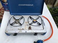 2 burner gas stove. Hardly used but some corrosion evident. In original box.