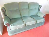 Three Piece Suite with Reversible backs and cushions.