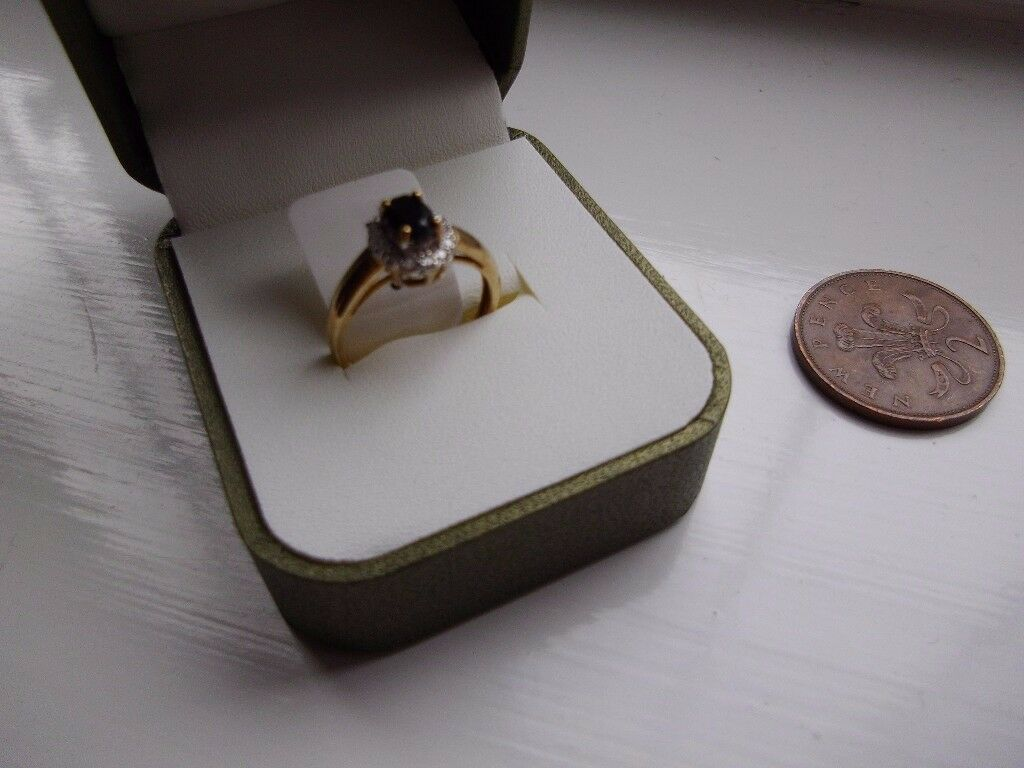 New boxed gold ring SIZE L with genuine stones. Swindon.