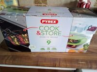 New 9 piece Pyrex set (has lids) still boxed for oven, microwave and fridge use