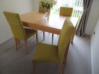 Beautiful Maple Dining Table and four matching chairs.