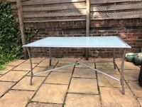 Large rectangular glass topped garden table with 6 matching chairs