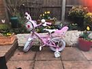 Kids Apollo Cupcake bike with safety pads