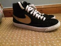 Size 4 black and gold Nike blazers