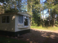 STATIC CARAVAN IN A SUPERB POSITION ON THE EDGE OF A COUNTRY PARK