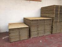 Wooden feather edge fence panels