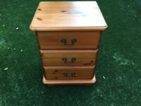 Bedside cabinet, 3 drawer, wooden with metal handles.